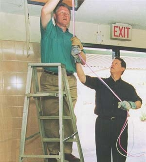 Clinton and Gore Installing Ethernet Wires
